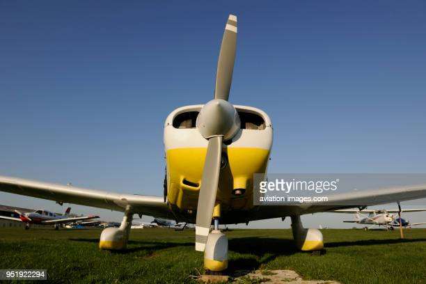 Propellers of Piper PA-28-161 Cherokee Warrior 2 and Cessna 152 parked on the grass.