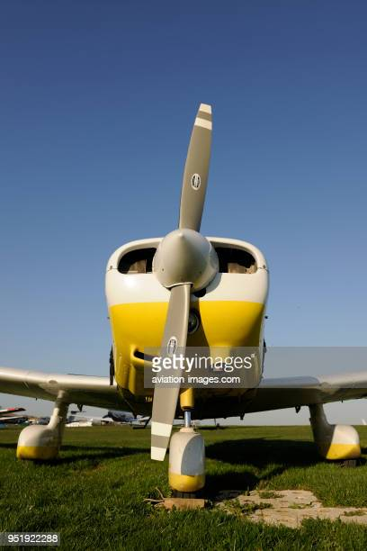 Propellers of Piper PA-28-161 Cherokee Warrior 2 parked on the grass.
