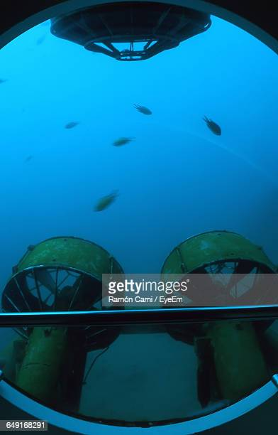 propellers seen through window of submarine in sea - submarine stock pictures, royalty-free photos & images