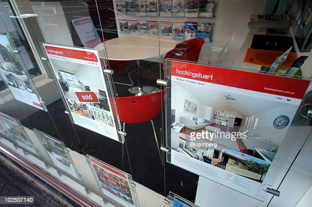 Properties are advertised for sale in the window of real estate agent Hocking Stuart, in Carlton, an inner suburb of Melbourne, Australia, on Monday,...