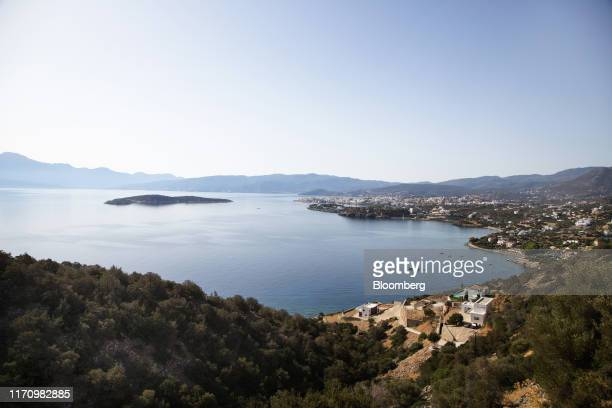 Properties stand along the coastline in a small town on the eastern side of the island of Crete, Greece, on Tuesday, Sept. 24, 2019. Like Crete,...