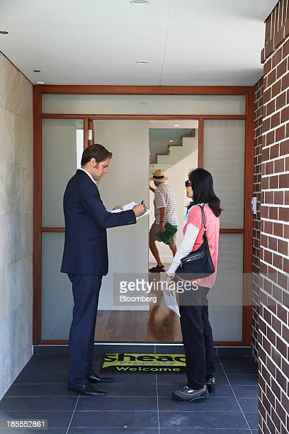 A property agent takes down a prospective buyer's details during an open house inspection at a property in the suburb of Willoughby in Sydney...