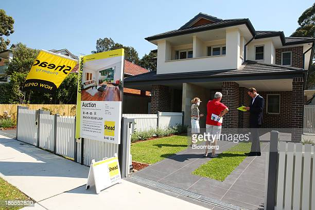 A property agent takes down prospective buyers' details during an open house inspection at a property in the suburb of Willoughby in Sydney Australia...