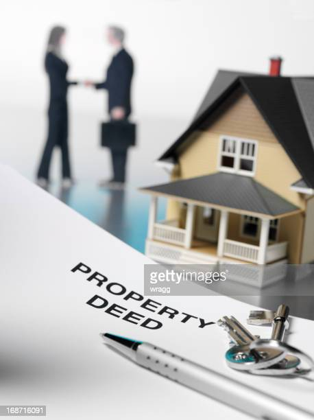 property deed and house - deed stock photos and pictures
