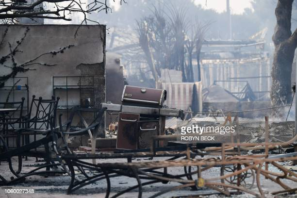 Property destroyed by the Woolsey Fire smolders in the Point Dume neighborhood of Malibu California on November 10 2018 after the fire tore through...