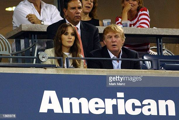 Property developer Donald Trump sits with his girlfriend Melania Knauss watching the Pete Sampras match at the 2002 USOpen in Flushing Meadows New...