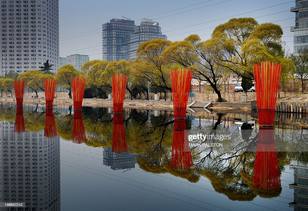 A property development is seen beside a canal in Beijing on November 18, 2012. President Hu Jintao recently called for a new Chinese growth model, marked by greater domestic demand and private enterprise, to ensure the long-term health of the world's second largest economy. AFP PHOTO/Mark RALSTON
