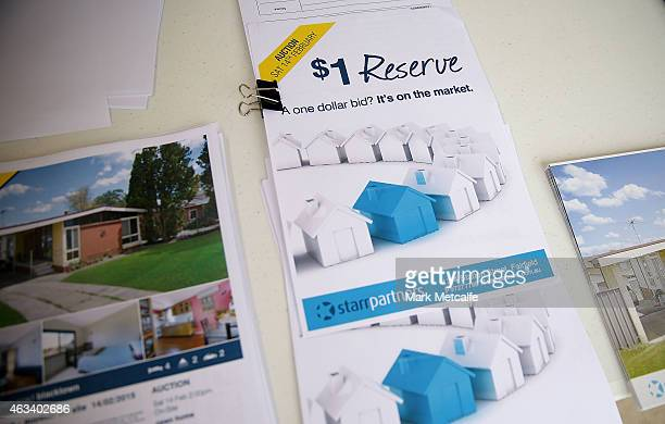 Property display cards are seen during the home auction for a fourbedroom house at 230 Blacktown Road on February 14 2015 in Blacktown Australia The...