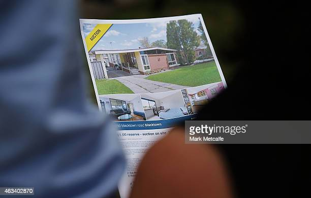Property display leaflets are seen during the home auction for a fourbedroom house at 230 Blacktown Road on February 14 2015 in Blacktown Australia...