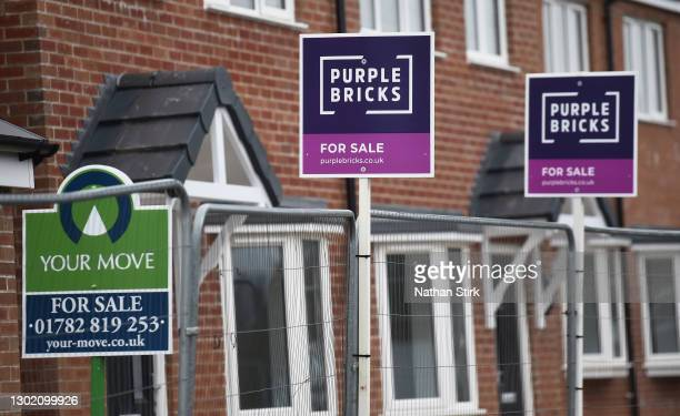 Property For Sale boards for Purple Brick Estate agents are seen advertising properties for sale February 14, 2021 in Biddulph, England .