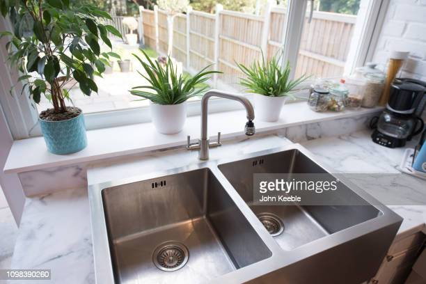 property interiors - kitchen sink stock pictures, royalty-free photos & images