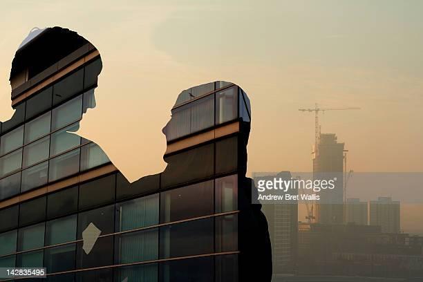 Property investors against highrise skyline