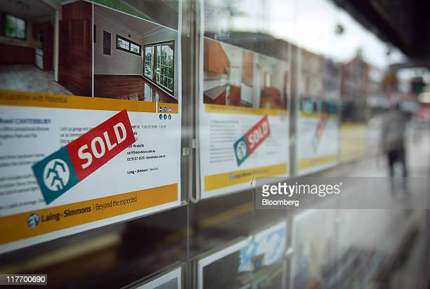 Property listings are displayed in the window of a real estate agency in Sydney Australia on Tuesday June 28 2011 Australian home prices surged in...