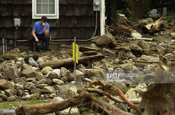 A property owner surveys his flooddamaged land in frustration August 15 in Sparta NJ After days of heavy rains flooded areas of northwestern New...