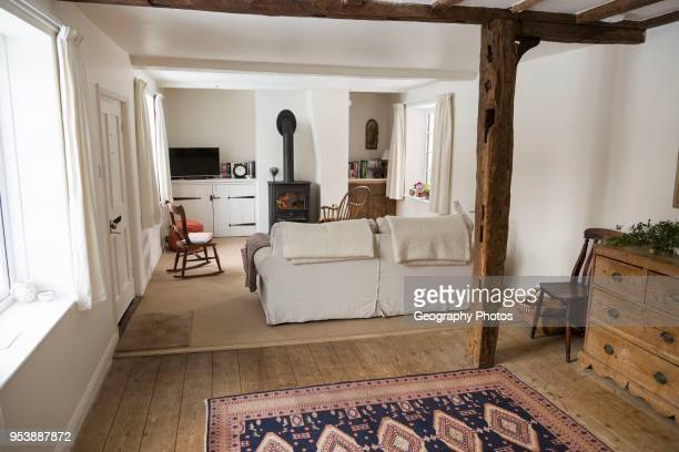 Property Released white painted interior of historic cottage living room Suffolk England UK