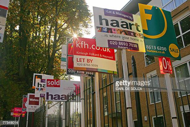 Property sale boards are pictured in Forest Hill in southeast London 15 October 2007 AFP PHOTO/CARL DE SOUZA