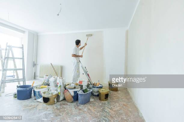 property service - architect painters and workers - renovation stock pictures, royalty-free photos & images