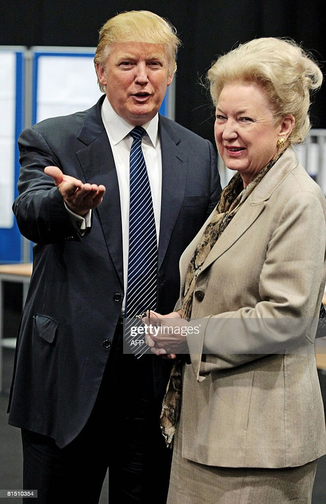 US property tycoon Donald Trump (L) is pictured with his sister Maryanne Trump Barry as they adjourn for lunch during a public inquiry over his plans to build a golf resort near Aberdeen, at the Aberdeen Exhibition & Conference centre, Scotland, on June 10, 2008. Trump wants to build a giant complex on the Scottish east coast near Aberdeen, but has run into opposition from environmentalists and a local farmer who refuses to budge. The Scottish government has called for a full public inquiry into the plans. AFP PHOTO/Ed Jones