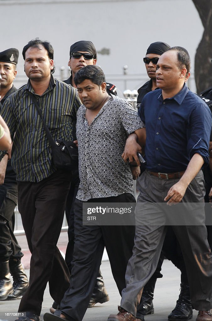 Property tycoon Sohel Rana (C) is escorted to a press conference at the Rapic Action Battalion (RAB) headquarters in Dhaka on April 28, 2013. Bangladesh police on Sunday arrested the owner of a garment factory block that collapsed last week killing more than 375 people as hopes faded for survivors at the disaster site.