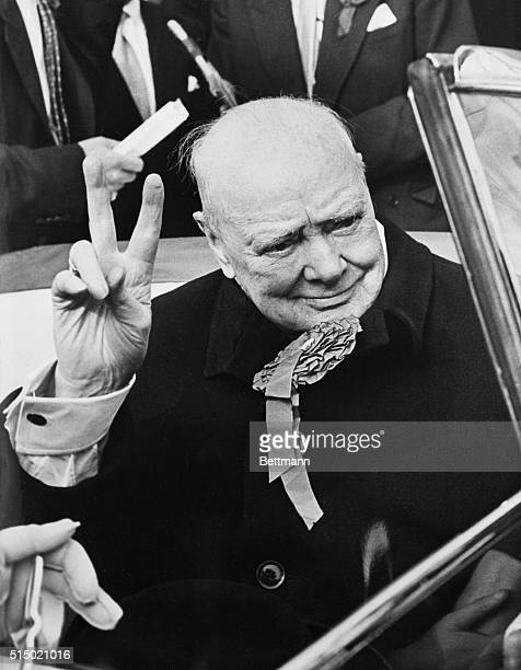 Prophetic Gesture London Former British Prime Minister Sir Winston Churchill displays the victory sign during election tour of his nearby Woodford...