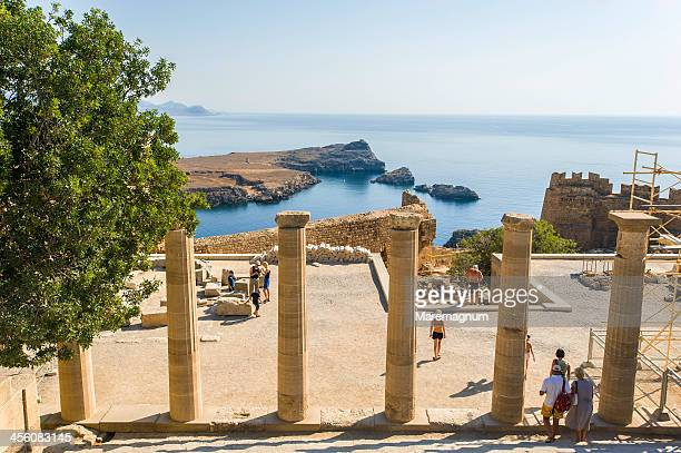 propilei of acropolis - lindos stock photos and pictures