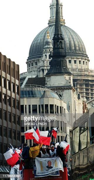 ProPinochet protestors ride on an opentop bus through the streets of London 10 December a day after British Home Secretary Jack Straw announced his...