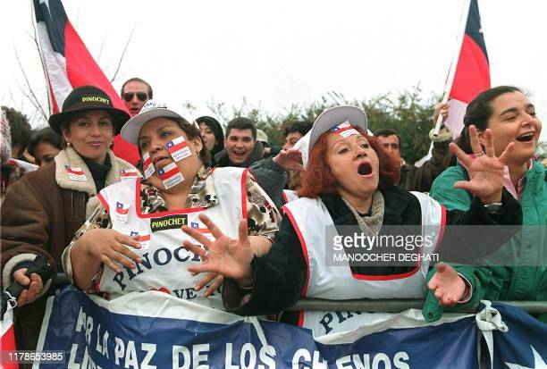 ProPinochet supporters chant slogans outside the maximum security Belmarsh Magistrates Court 11 December outside London where former Chilean Dictator...