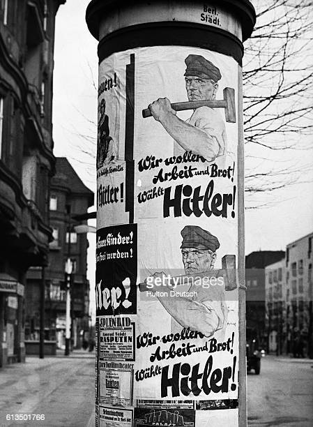 "Propoganda election posters in the streets of Berlin asking for the people to vote for Hitler. The poster reads ""We want work and bread, vote for..."