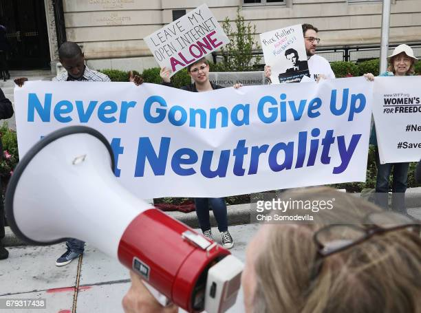Proponents of net neutrality protest against Federal Communication Commission Chairman Ajit Pai outside the American Enterprise Institute before his...