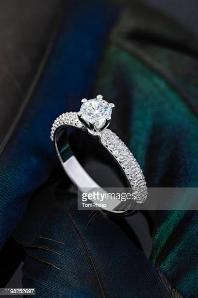 proposal diamond ring on black background - platinum stock pictures, royalty-free photos & images