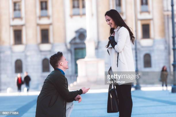 proposal in the street man asking marry to his girlfriend - love you stock photos and pictures