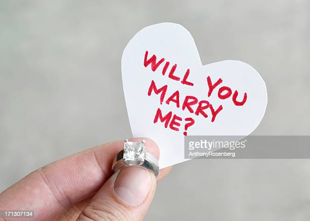 proposal - man holding engagement ring stock photos and pictures