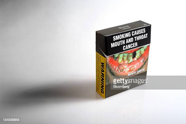A proposed cigarette packet to be introduced under Australia's cigarette plainpackaging law is arranged for a photograph in Melbourne Australia on...