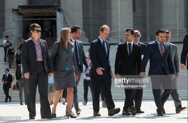 Proposition 8 plaintiff couples Kris Perry and Sandy Steier, and Paul Katami and Jeff Zarillo depart the Supreme Court on June 25, 2013.