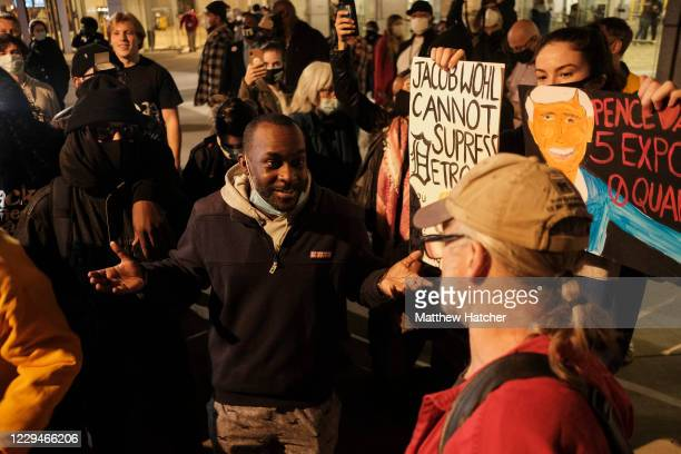 Pro-President Donald Trump and pro-Joe Biden protesters argue outside the TCF Center as votes continue to be counted on November 4, 2020 in Detroit,...