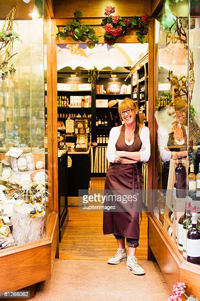 Proprietor in doorway of wine shop
