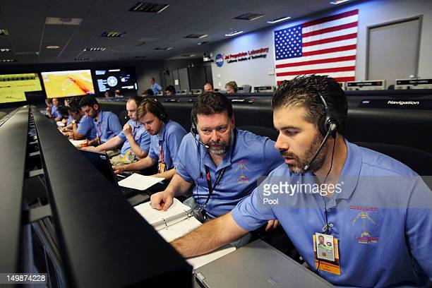 Propulsion engineers Todd Barber and Raymond Baker , work before landing inside the Spaceflight Operations Facility for NASA's Mars Science...