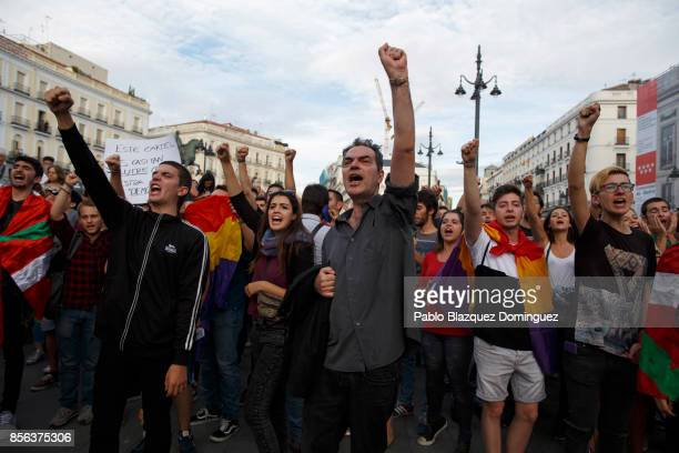 Proreferendum demonstrators shout slogans during a protest in support of Catalan's referendum and against government repression as Catalonian voted...