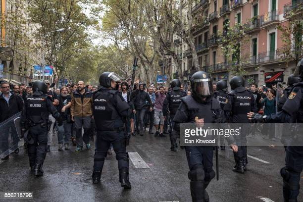 ProReferendum supporters clash with members of the Spanish National Police after police tried to enter a polling station to retreive ballot boxes...