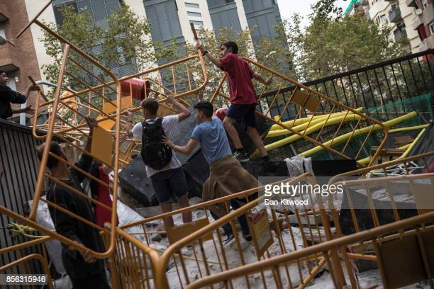 Proreferendum supporters create a barricade to prevent police officers gaining entry inside the Escola Industrial of Barcelona school polling station...