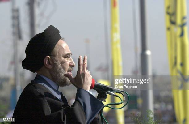 Pro-reform Iranian President Mohamed Khatami addresses one of the most strident anti-American demonstrations in years February 11, 2002 in Tehran,...