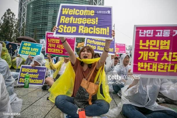 Prorefugee activists chant slogans as they hold pickets denouncing racism and welcoming refugees on September 16 2018 in Seoul South Korea Activists...
