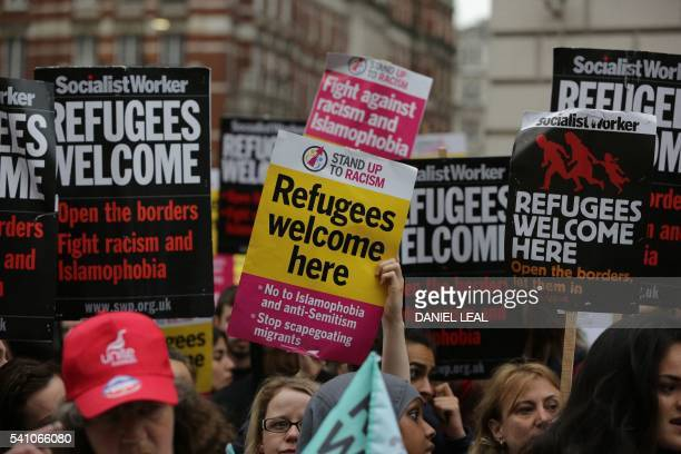 Prorefugee activists rally with placards outside the French Embassy in central London on June 18 2016 during a protest after most of an aid convoy of...