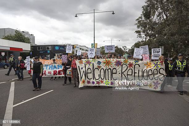 Prorefugee protesters march during pro and anti refugee rallies in Eltham Melbourne Australia on November 05 2016 The rally was called to oppose the...