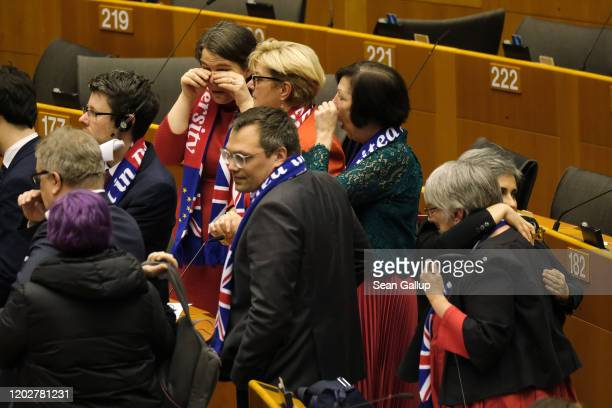 ProRemain MPs of the European Parliament hug and wipe away tears following a historic vote for the Brexit agreement at a session of the European...