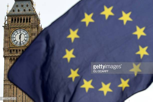 A proremain protester holds up an EU flag near the Elzabeth Tower commonly known as Big Ben at the Houses of Parliament shortly after British Prime...