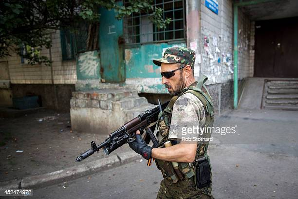 A proRussia rebel patrols a residential area close to the central railway station on July 21 2014 in Donetsk Ukraine Local authorities warned...