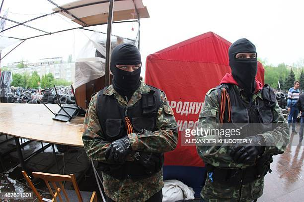 ProRussia separatists stand guard outside the regional state building seized by separatists eastern Ukrainian city of Donetsk on May 2 2014 ProMoscow...