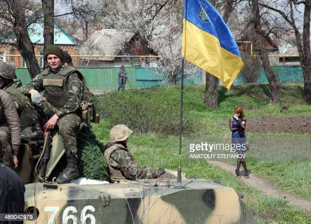 ProRussian activists block a column of Ukrainian soldiers riding on Armoured Personnel Carriers in the eastern Ukrainian city of Kramatorsk on April...