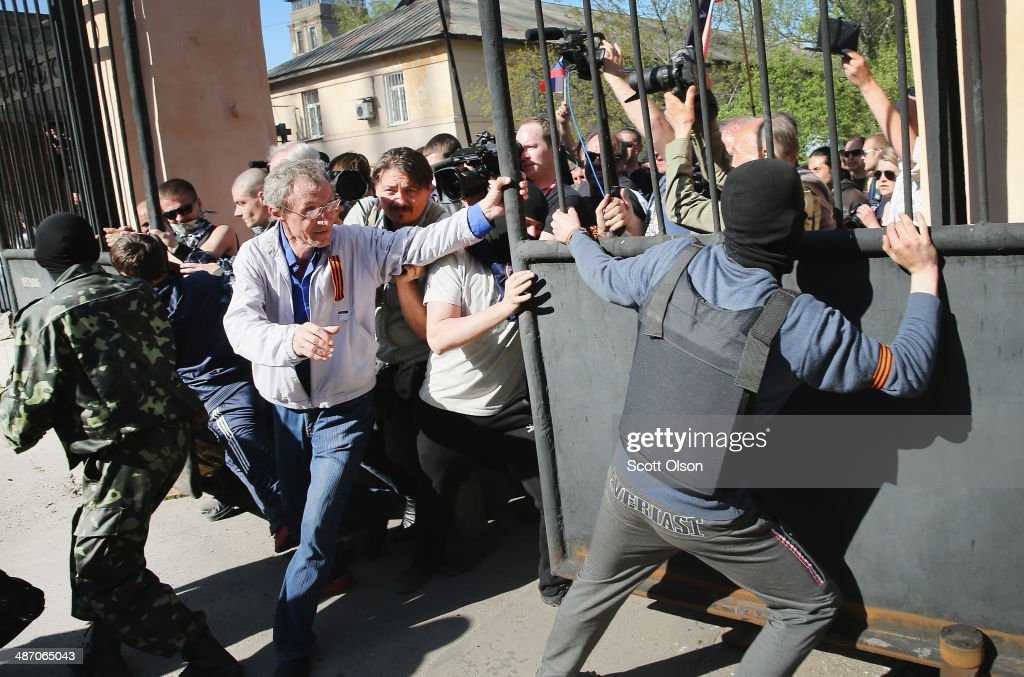Pro-Russian activists break through the gate in front of TRK Donbass television station on April 27, 2014 in Donetsk, Ukraine. A group of about 500 activists marched to the building and met little resistance as they broke through the gate and the front door of the facility to take control of the building. Several bands of activists, similar to those in Donetsk, have been occupying government buildings in other eastern Ukraine cities in recent weeks.